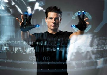 Tom Cruise in the movie Minority Report, using his 2 hands to manipulate objects in a virtual screen